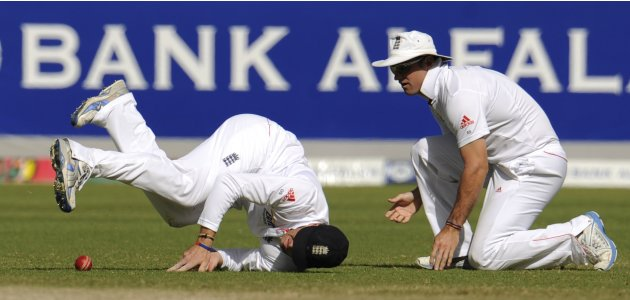 England's Swann drops a catch from the bat of Pakistan's Ali as his teammate Strauss looks on during their third cricket test match at Dubai International Cricket Stadium in Dubai