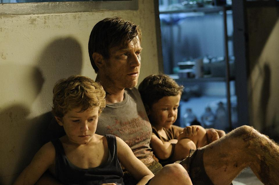 "This publicity film image released by Summit Entertainment shows, from left, Samuel Joslin, Ewan McGregor and Oaklee Pendergast in a scene from ""The Impossible."" (AP Photo/Summit Entertainment, Jose Haro)"