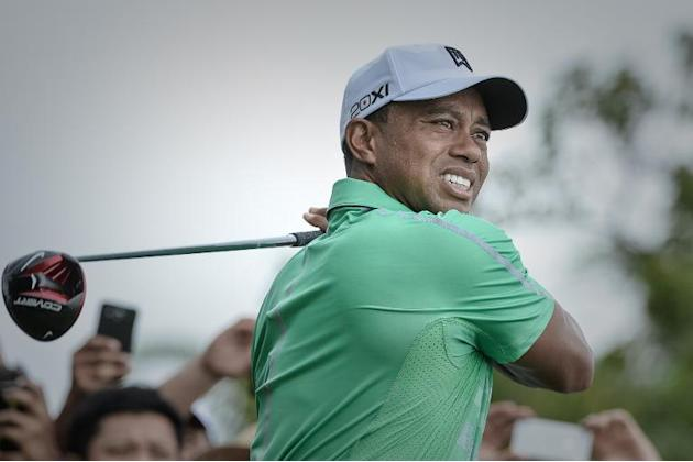 US golfer Tiger Woods tees off during his one-on-one golf matchup against Northern Irish golfer Rory McIlroy at Mission Hills in Haikou on October 28, 2013