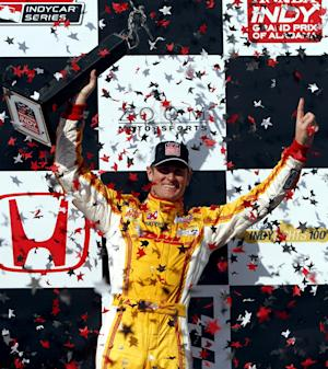 Ryan Hunter-Reay celebrates in Victory Lane after winning the IndyCar Series Grand Prix of Alabama auto race in Birmingham, Ala., Sunday, April 7, 2013. (AP Photo/Butch Dill)
