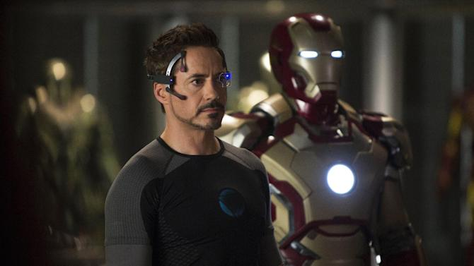"""This undated publicity image released by Marvel shows Robert Downey Jr., as Tony Stark/Iron Man, in a scene from """"Marvel's Iron Man 3.""""  """"Marvel's Iron Man 3"""" was one of several upcoming films to receive spotlight treatment with an ad that aired during Super Bowl XLVII on Sunday, Feb. 3, 2013. (AP Photo/Marvel, Zade Rosenthal)"""