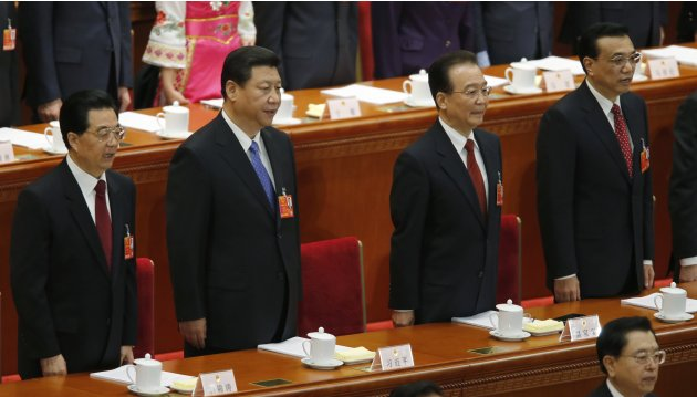 China's President Hu, China's Communist Party Chief Xi, Premier Wen and China's Vice-Premier Li sing the national anthem during the opening ceremony of National People's Congress at the Great Hall of