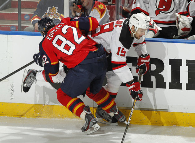 Tomas Kopecky #82 Of The Florida Panthers Checks Petr Sykora #15 Of The New Jersey Devils In Game Five Of The Eastern Getty Images