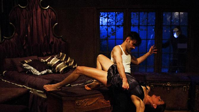 """This theater image released by the O & M Co., shows Nicholas Bruder as Macbeth and Sophie Bortolussi as Lady Macbeth during a performance of """"Sleep No More,"""" in New York. (AP Photo/The O & M Co., Yaniv Schulman)"""