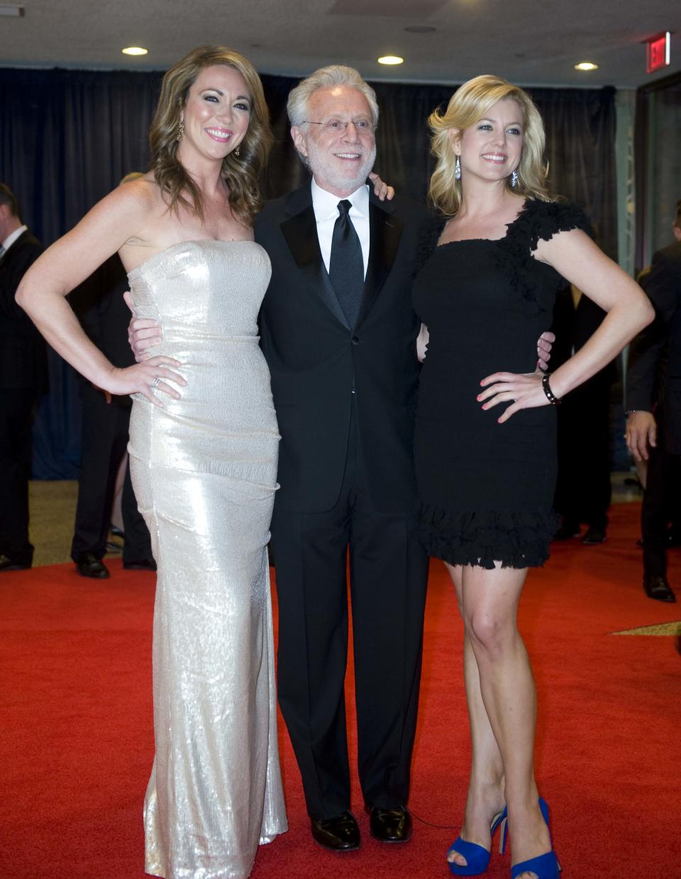 Journalist Wolf Blitzer, center, arrives at the White House Correspondents' Association Dinner with his guests on Saturday, April 28, 2012, in Washington. (AP Photo/Kevin Wolf)
