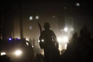 Afghan policeman keeps watch at the site of an attack in Kabul