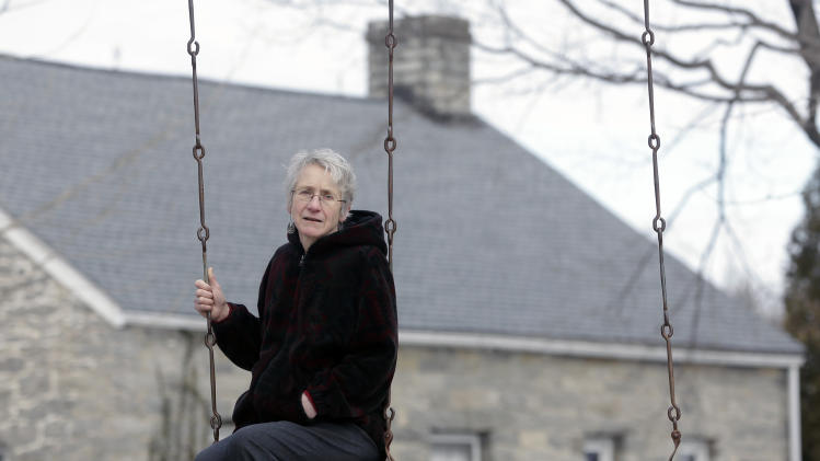 In this Thursday, Feb. 7, 2013 photo, Deborah Lain sits on a swing at her family's Kezialain Farm in Westtown, N.Y. The farm is close to a natural gas pipeline and the construction site of a natural gas compressor station in nearby Minisink. (AP Photo/Mike Groll)