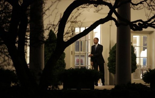<p>US President Barack Obama leaves the White House after delivering a statement late January 1, 2013 in Washington DC. Obama has signed into law the contentious compromise bill hammered out in Congress, narrowly averting the US 'fiscal cliff' of tax hikes and drastic, immediate cuts in spending, the White House said early Thursday</p>