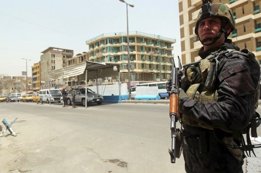 &lt;p&gt;An Iraqi policeman mans a checkpoint in Baghdad in May 2012. Two car bombs in the town of Mahmudiyah, south of Baghdad, killed at least 10 people and wounded dozens on Sunday evening, medical officials said.&lt;/p&gt;