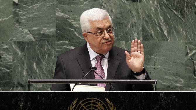 """in United Nations General Assembly, Thursday, Nov. 29, 2012. In a statement Thursday, Palestinian President Mahmoud Abbas appealed to all nations to vote in favor of the Palestinians """"as an investment in peace.""""  (AP Photo/Richard Drew)"""