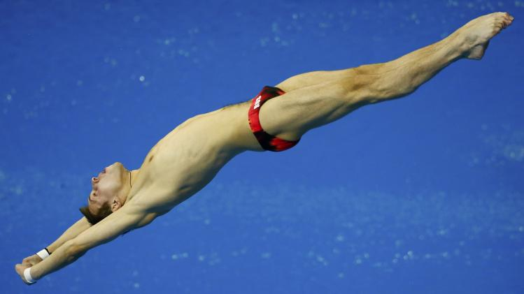 Minibaev of Russia performs to win during the men's 10m platform final at the European Swimming Championships in Berlin