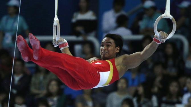 Singapore's Muhammad Jufrie bin Aizat competes on the men's rings event of the team gymnastics competition at the Namdong Gymnasium Club during the 17th Asian Games in Incheon