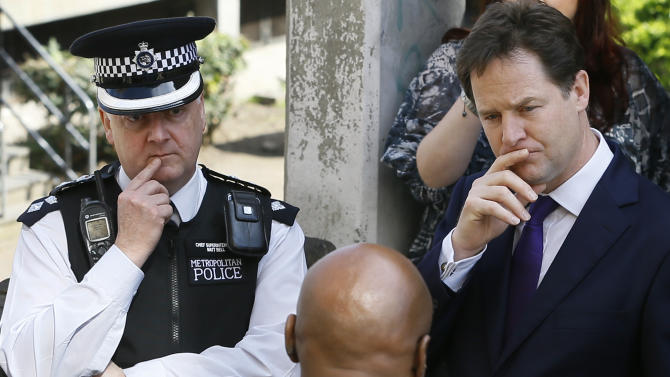 Britain's Deputy Prime Minister Nick Clegg, right, and Lambeth Borough Commander Matt Bell, left, visit a housing estate in Brixton in London, Thursday, April 25, 2013. The Deputy Prime Minister visited a housing estate in Brixton with Jeremy Browne, Minister for Crime Prevention, to meet with police and community workers to see how crime is being tackled in the area. (AP Photo/Kirsty Wigglesworth, pool)