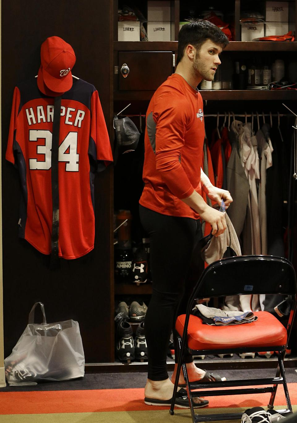Washington Nationals center fielder Bryce Harper stands by his locker after Game 5 of the National League division baseball series against the St. Louis Cardinals on Saturday, Oct 13, 2012, in Washington. St. Louis won 9-7. (AP Photo/Pablo Martinez Monsivais)