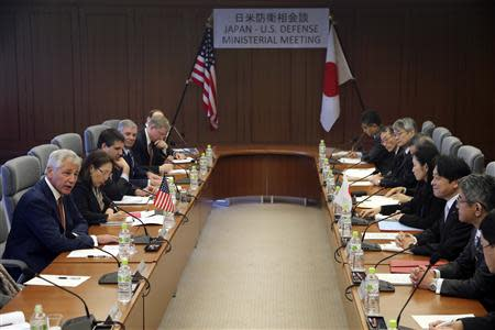 U.S. Defense Secretary Hagel speaks as Japan's Defense Minister Onodera listens during their meeting in Tokyo