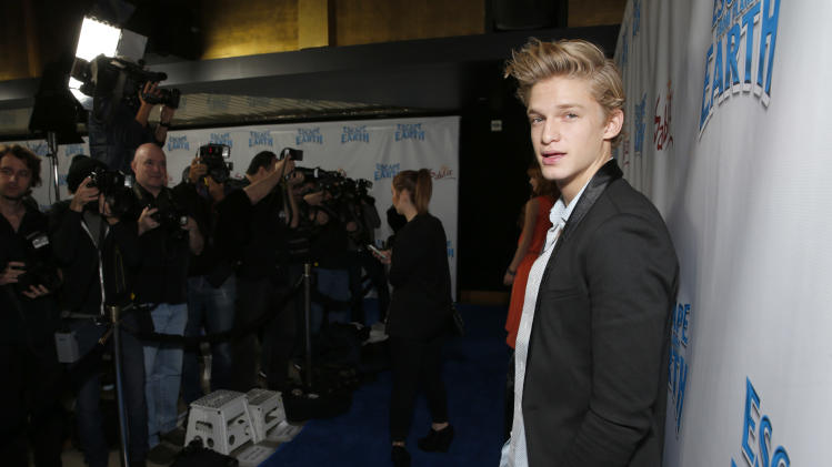 "Cody Simpson attends the LA premiere of ""Escape from Planet Earth"" at the Chinese Theater on Saturday, Feb. 2,2013 in Hollywood. (Photo by Todd Williamson/Invision/AP Images)"