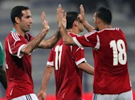 Egypt's Mohammed Abu Trika (L) celebrates with teammates after scoring a goal during a recent match played in Dubai, in April. Egypt switch attention from the World Cup to the Africa Cup of Nations on Friday when they host the Central African Republic behind closed doors in the Mediterranean city of Alexandria