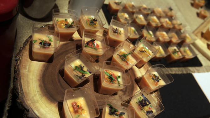 In this Wednesday, Aug. 13, 2014 photo, Tuscan melon gazpacho with Thai basil and blush-tiger tomatoes, from The Lodge at Woodloch, in Hawley, Pa., is displayed at the International Spa Association event, in New York. The ISPA's annual industry show was a feast for the senses, with treats and treatments that smelled good, felt good and tasted good. (AP Photo/Richard Drew)