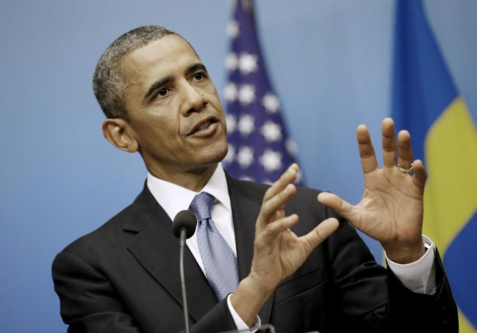 President Barack Obama gestures as he answers questions during a joint news conference with Swedish Prime Minister Fredrik Reinfeldt, Wednesday, Sept. 4, 2013, at the Rosenbad Building in Stockholm, Sweden. (AP Photo/Pablo Martinez Monsivais)