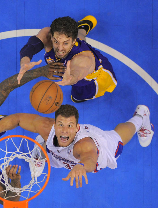 Los Angeles Clippers forward Blake Griffin, below, and Los Angeles Lakers center Pau Gasol, of Spain, battle for a rebound during the second half of an NBA basketball game, Friday, Jan. 10, 2014, in L