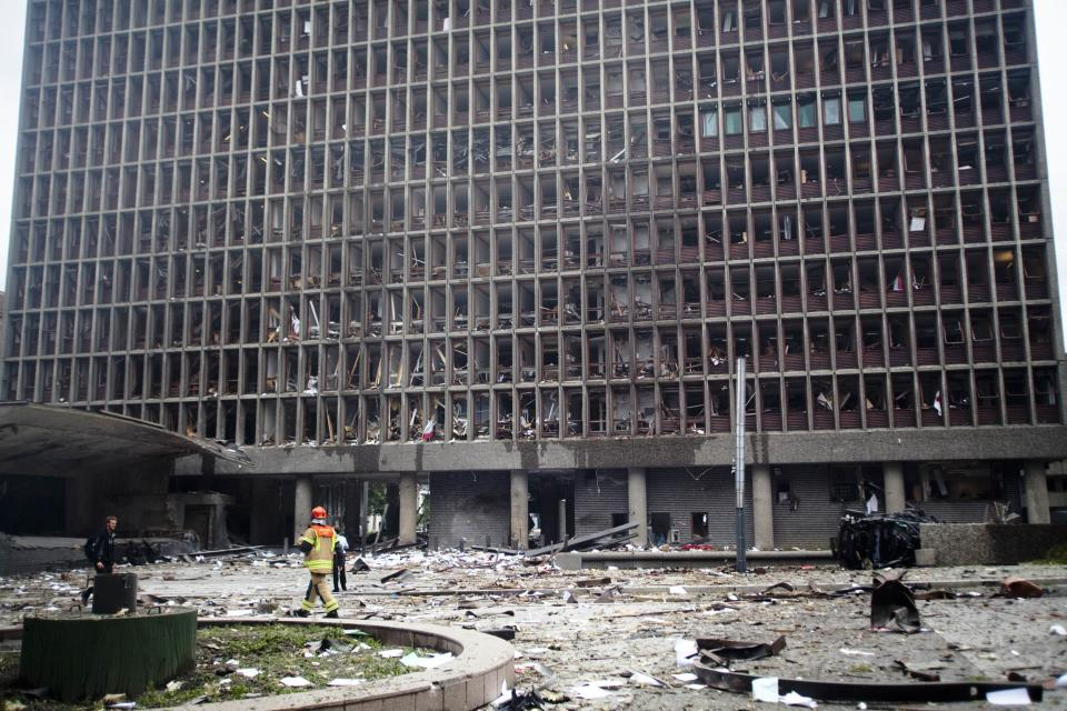 Debris covers the area outside a building in the centre of Oslo, Friday July 22, 2011, following an explosion that tore open several buildings including the prime minister's office, shattering windows and covering the street with documents. (AP Photo/Fartein Rudjord)