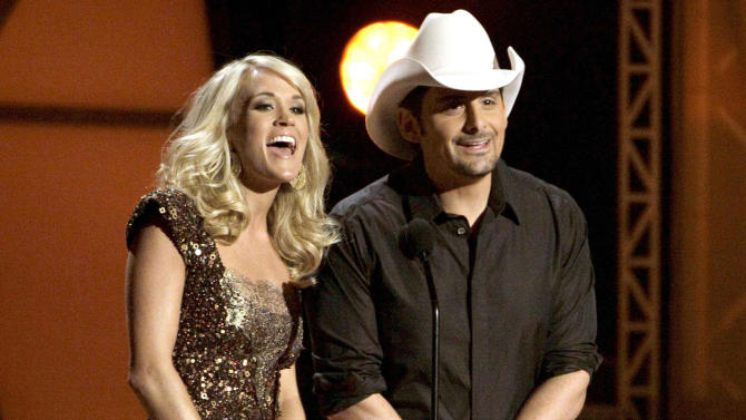 "FILE - In this Nov. 9, 2011 file photo hosts Carrie Underwood, left, and Brad Paisley speak during the 45th Annual CMA Awards in Nashville, Tenn. The former ""American Idol"" winner's latest album ""Blown Away"" was a multi-week No. 1 on the country albums chart, she's in the midst of an arena tour and she also is up for female vocalist of the year at the CMA Awards, on Thursday, Nov. 1, 2012, airing live on ABC at 8 p.m. EDT from Nashville's Bridgestone Arena. (AP Photo/Mark Humphrey, File)"