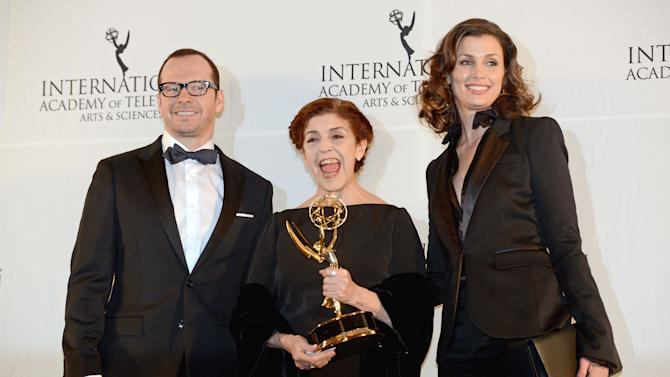 "Argentine actress Cristina Banegas, center, poses with presenters Donnie Wahlberg, left, and Bridget Moynihan after winning the Best Performance by an Actress award for her role in the miniseries ""Television por la Inclusion,"" at the 40th International Emmy Awards,  Monday, Nov. 19, 2012 in New York.  (AP Photo/Henny Ray Abrams)"