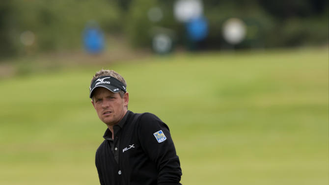 England's Luke Donald reacts after a wayward shot off the off the 2nd fairway during a practice round at the Royal Lytham & St Annes golf club before the forthcoming British Open Golf tournament, Lytham St Annes, England, Monday July 16, 2012. (AP Photo/Jon Super)