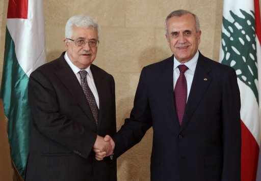 Lebanon's President Suleiman shakes hands with Palestinian President Abbas at the Presidential Palace in Baabda