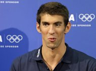 FILE - In this file photo taken Aug. 5, 2012, United States swimmer Michael Phelps speaks during a news conference at the Summer Olympics in London. Phelps' longtime agent, Peter Carlisle, dismissed any suggestion Friday, Aug. 18, 2012, that the retired swimmer may have violated International Olympic Committee rules when provocative pictures for the Louis Vuitton campaign were leaked on the Internet during the London Games. (AP Photo/Kirsty Wigglesworth, file)