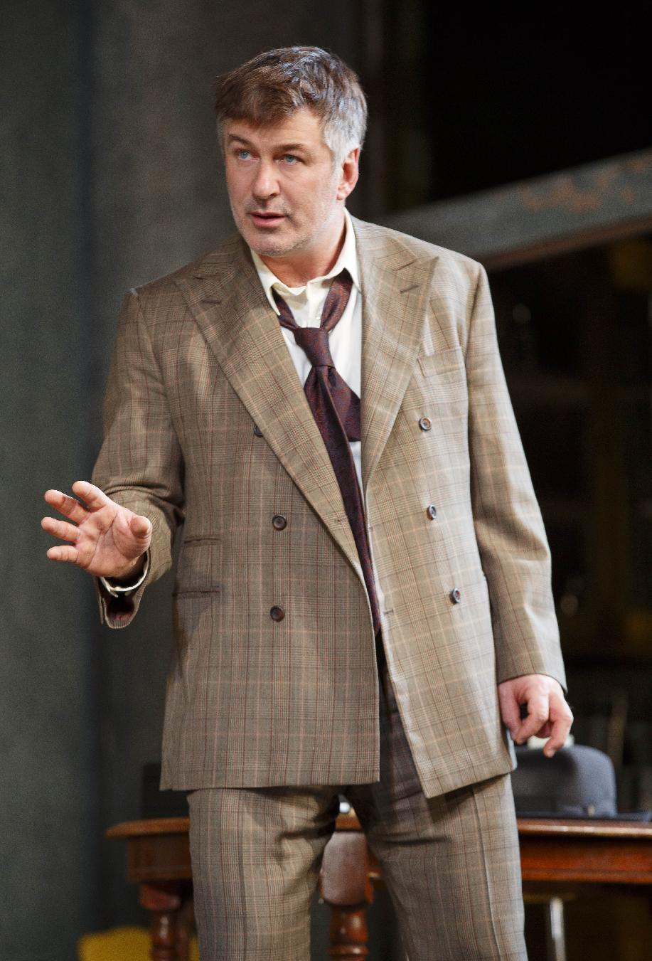 "This theater image released by Boneau/Bryan-Brown shows Alec Baldwin during a performance of ""Orphans,"" at the Gerald Schoenfeld Theatre in New York. (AP Photo/Boneau/Bryan-Brown, Joan Marcus)"