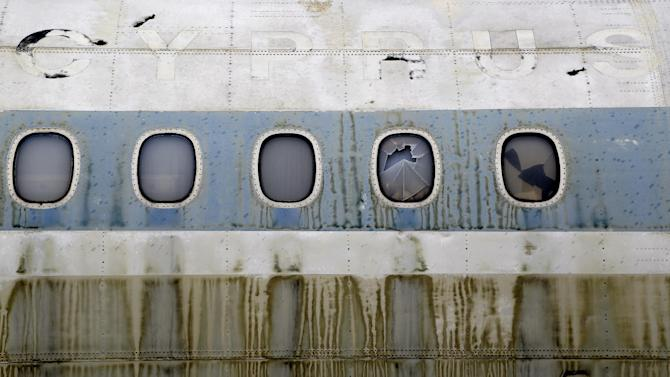 In this Tuesday, Nov. 25, 2014 photo, the rusting, discolored exterior of the fuselage of an Cyprus Airways Trident passenger jet parked on the tarmac of the long-abandoned Nicosia airport that lies inside a United Nations-controlled buffer zone separating the breakaway Turkish speaking north of ethnically divided Cyprus from the internationally recognized Greek speaking south. Once an emblem of the young republic's growing confidence just 14 years after independence from British colonial rule, the airport overnight became a symbol of a future hijacked by unresolved conflict. (AP Photo/Petros Karadjias)