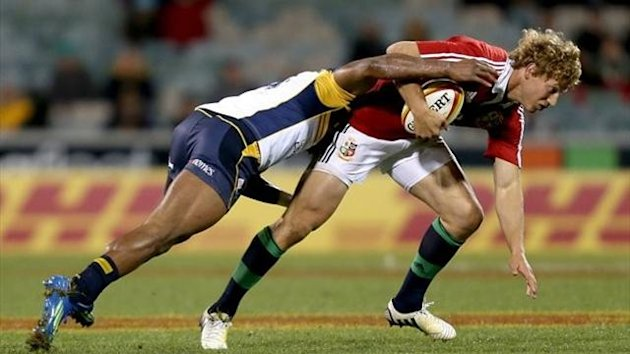 British and Irish Lions' Billy Twelvetrees (right) in action with ACT Brumbies' Tevita Kuridrani