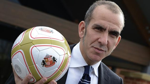 Sunderland's new coach Paolo Di Canio poses for photographs during a media conference at the football club's training academy