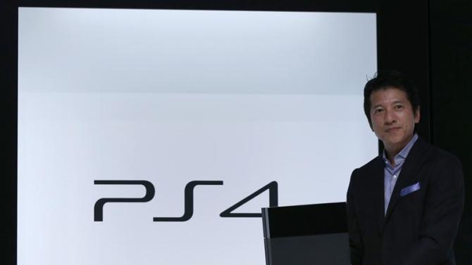 Sony Computer Entertainment Japan Asia President Kawano poses with the company's PlayStation 4 in Tokyo