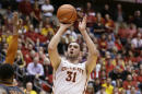 Iowa State forward Georges Niang (31) shoots over Texas guard Javan Felix, right, during the first half of an NCAA college basketball game, Monday, Jan. 26, 2015, in Ames, Iowa. (AP Photo/Charlie Neibergall)