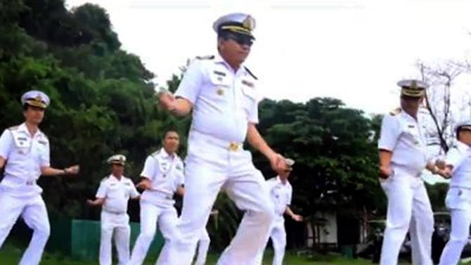 """In this image made from an undated video released by Thai Royal Navy, Thai sailors perform the rodeo-style dance and other hip-shaking moves at their base on the popular tourist island of Phuket, southern Thailand. The """"Gangnam Style"""" craze has reached Thailand's navy, which is among the latest to mimic the globally popular dance video by South Korean singer PSY. (AP Photo/Royal Thai Navy) EDITORIAL USE ONLY, NO SALES"""