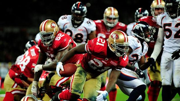 San Francisco 49ers Frank Gore (C) celebrates as he scores a touchdown against the Denver Broncos during their NFL football game at Wembley Stadium