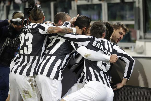 Juventus' Llorente celebrates with his team mates after scoring against Udinese during their Italian Serie A soccer match in Turin