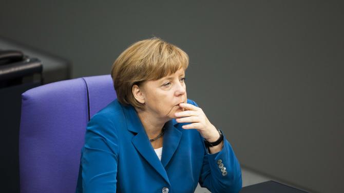 German Chancellor Angela Merkel reacts during the debate after her speech for the upcoming EU summit at the German parliament Bundestag in Berlin, Wednesday, June 27, 2012. Germany faces increasing pressure to relent on its resistance to jointly issued eurobonds and other forms of debt-pooling ahead of a European Union summit Thursday. (AP Photo/Markus Schreiber)