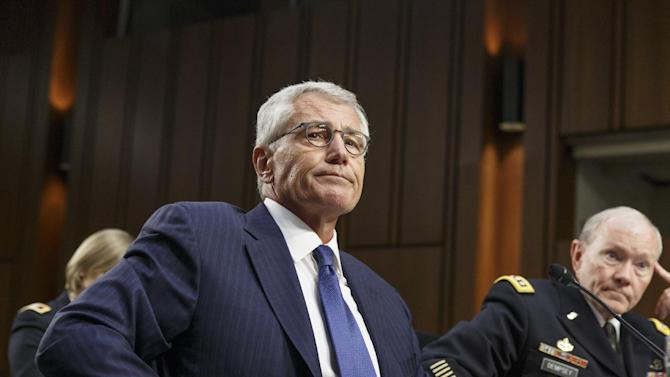 FILE In this photo taken Tuesday, Sept. 16, 2014, Defense Secretary Chuck Hagel, left, and Army Gen. Martin Dempsey, chairman of the Joint Chiefs of Staff, appear before the Senate Armed Services Committee, the first in a series of high-profile Capitol Hill hearings.   Defense Secretary Hagel resigning from Obama Cabinet Monday.    (AP Photo/J. Scott Applewhite/File)