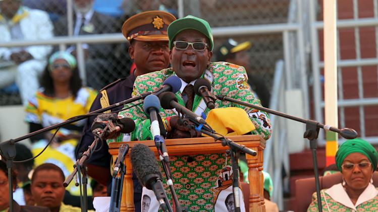 Zimbabwean President and Zanu PF leader President Robert Mugabe addresses party supporters at his last campaign rally in Harare, Sunday, July, 28, 2013. Mugabe is set to contest against his main rival Morgan Tsvangirai in an election set for July 31. (AP Photo/Str)