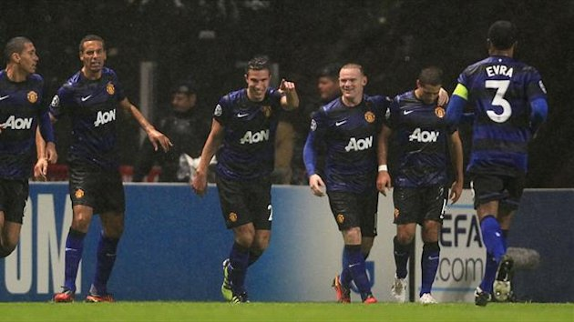 Robin van Persie celebrates his equaliser for Manchester United at Sporting Braga