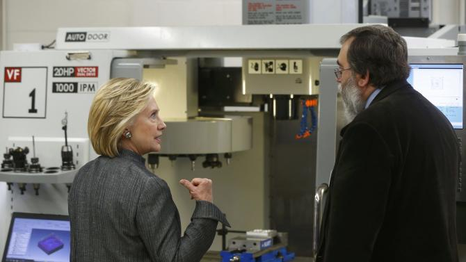 U.S. presidential candidate Clinton talks with  Arredondo at New Hampshire Technical Institute while campaigning for the 2016 Democratic presidential nomination in Concord