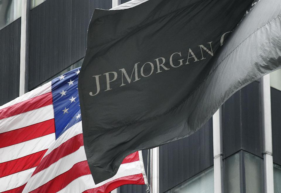 The corporate flag for JPMorgan Chase flies at corporate headquarters, Monday, May 14, 2012 in New York. JPMorgan, the largest bank in the United States, is seeking to minimize the damage caused by a $2 billion trading loss, disclosed Thursday by CEO Jamie Dimon. (AP Photo/Mark Lennihan)