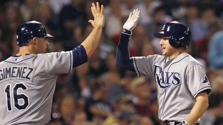 Tampa Bay Rays' Elliot Johnson, right, is congratulated by  Chris Gimenez after his two-run home run off Boston Red Sox starting pitcher Jon Lester during the fourth inning of a baseball game at Fenway Park in Boston, Friday, May 25, 2012. (AP Photo/Charles Krupa)