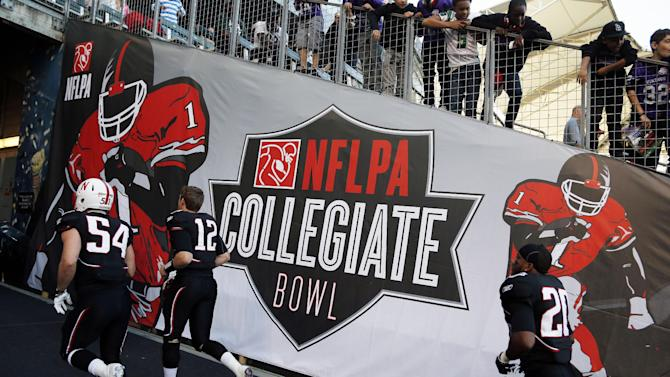 The National team makes it's way through the tunnel at halftime during the NFLPA Collegiate Bowl on Saturday, Jan. 19, 2013 in Carson, Calif. (Ric Tapia/AP Images for NFLPA)