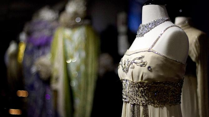 """This Oct, 3, 2012 photo shows the dress Julie Andrews worn while starring in the play, """"My Fair Lady"""" on display at the costume museum in Pompano Beach, Fla. Marilynn Wick and her daughter Kimberly opened a museum in 2011, showcasing more than one million costumes from nearly 50 shows, guiding daily tours through a non-de script South Florida warehouse against a backdrop of hand painted sets and a marquee replica from storied Broadway theaters like the Winter Garden.  (AP Photo/J Pat Carter)"""