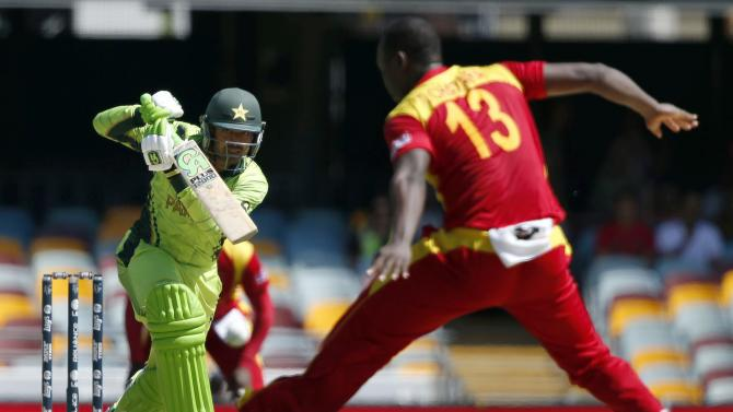 Zimbabwe's Tendai Chatara fails to stop a shot that goes to the boundary from Pakistan's Haris Sohail during their Cricket World Cup match at the GABBA in Brisbane
