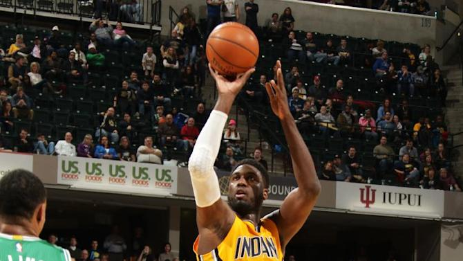 Pacers need OT to fend off Boston's late rally, 107-103